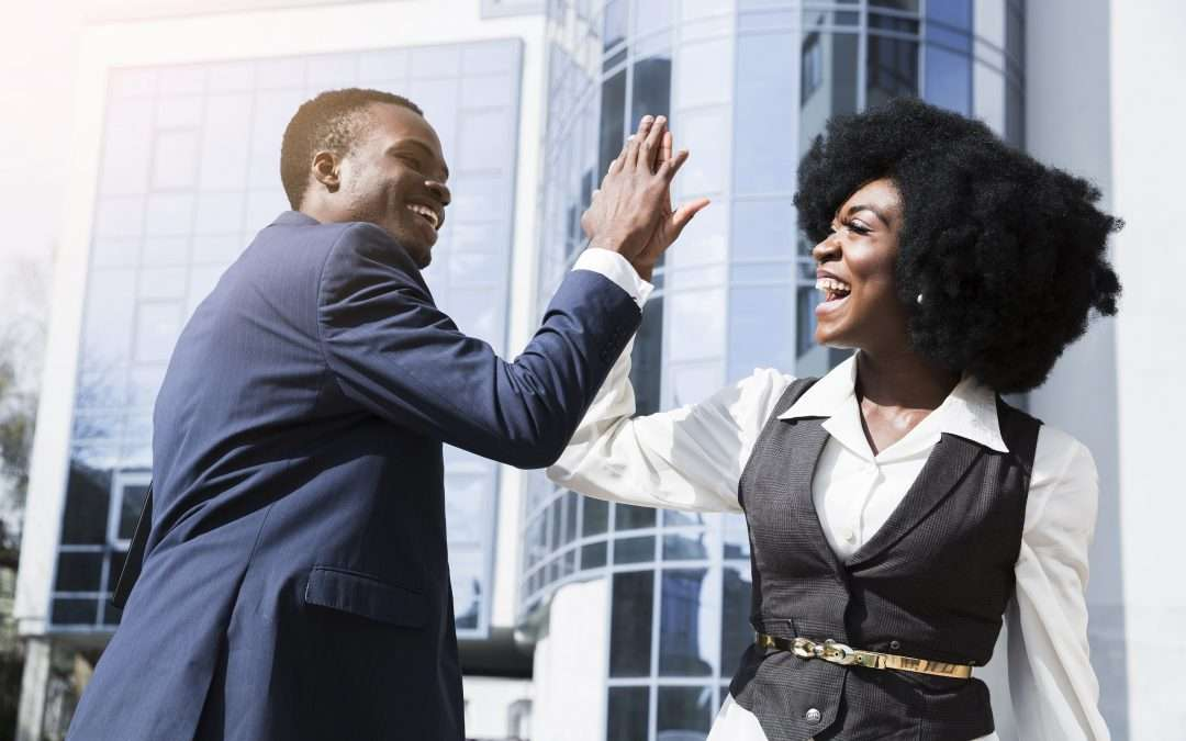 two people giving each other a hi-five